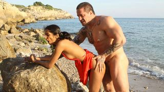 Arab girl fucked by a Viking on the beach