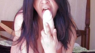 She puts her dildo in her pussy in front of her cam