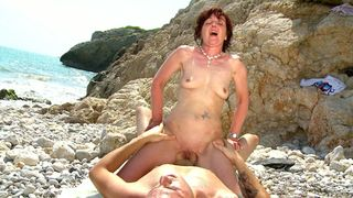 Young guy takes a milf to the beach and fucks her