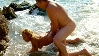 Hot couple have sex on the beach
