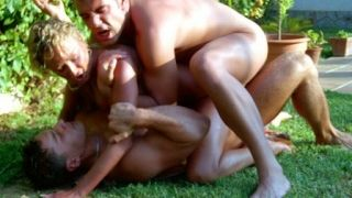 A gorgeous blonde fucked by two guys next to the pool