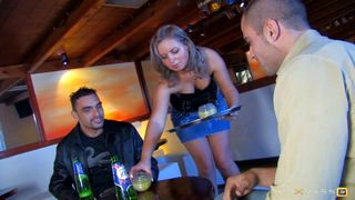 A waitress fucked in her bar by two customers